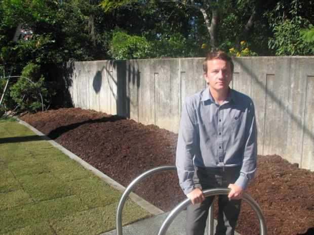 Tweed Shire Council Landscape Architect Ian Bentley in front of a garden from which five Lillypilly trees were stolen.