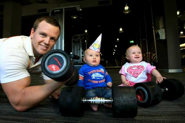 Ruby Wright and Jake Cleverley with strong man Tom Kingston. Photo: John Gass / Daily News