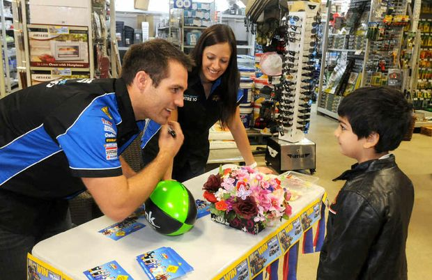 Contestants on Channel Nine's The Block, Dan Reilly and Dani Wales, chat to young fan Jibraan Khan at Mitre 10 Mackay yesterday. They were here as part of the Mighty Aussie Road Trip, which is taking them to Queensland's Mitre 10 stores.
