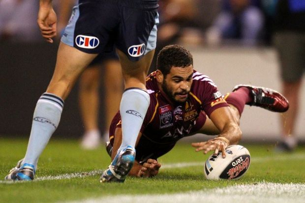 Greg Inglis of the Maroons scores a try during game one of the ARL State of Origin series between the Queensland Maroons and the New South Wales Blues at Etihad Stadium on May 23, 2012 in Melbourne, Australia.
