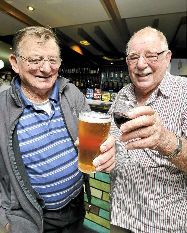 Devout beer drinker Rusty Britt, of Lismore, left, and wine drinker Bill Dempsey, of Tweed Heads, debate the merits of their chosen drops.