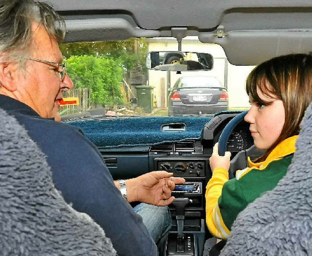 Drivers' College instructor Lyle Whitley instructs Emma Whitley on road safety.
