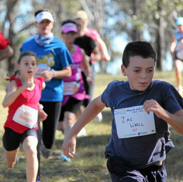 Zac Wall sprints to the finish line in the 4.6km cross country event on Saturday.