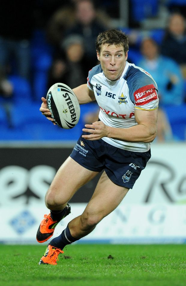Ashley Graham of the Cowboys runs the ball in attack during the round 13 NRL match between the Gold Coast Titans and the North Queensland Cowboys at Skilled Park