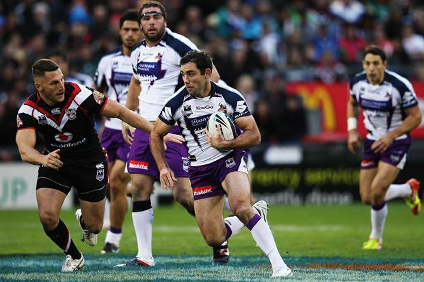 Cameron Smith of the Storm makes a break during the round 13 NRL match between the New Zealand Warriors and the Melbourne Storm at Mt Smart Stadium