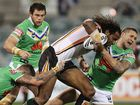 Lote Tuqiri of the Tigers is tackled during the round 13 NRL match between the Canberra Raiders and the Wests Tigers at Canberra Stadium