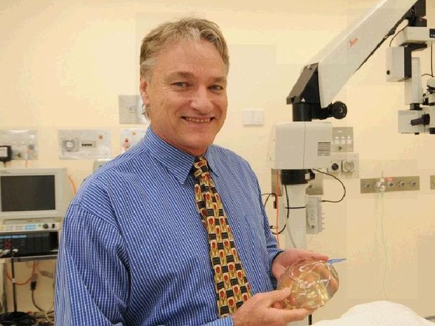 Mater Misericordiae Day unit's Dr Mark Vucak (holding a breast implant) sees patients for all different plastic surgeries as cosmetic procedures have become more affordable.