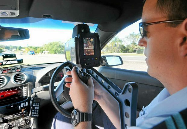 Senior Constable Keith Preston tries out the TruCAM on the roads.
