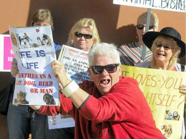 Protesters rally against animal cruelty outside the Gladstone Magistrates Court.
