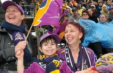 Melbourne fans Jodie Johnson, Mitchell Brown and his mum, Kerry Christensen, moved to Rockhampton four years ago and still love the Storm.