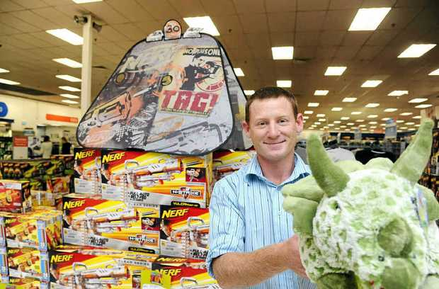 Grafton Big W toy section business manager Rob Third with just a few of the many toys which have been during the massive toy sales.