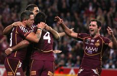 Justin Hodges of the Maroons celebrates with team mates after scoring a try during game three of the 2012 State of Origin series between the Queensland Maroons and the New South Wales Blues at Suncorp Stadium on July 4, 2012 in Brisbane.