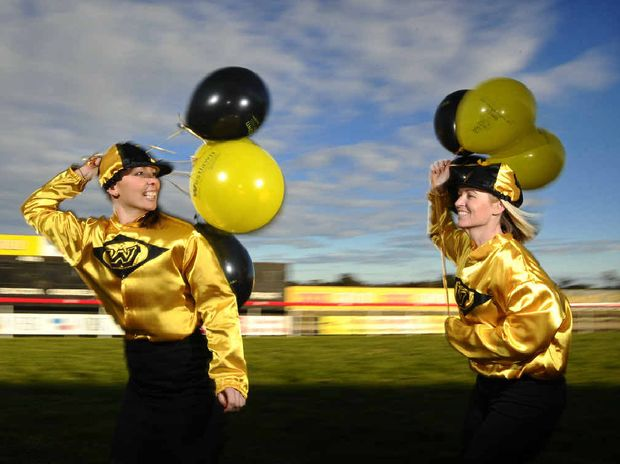 Sarah Templeton and Danielle Cunningham of Westlawn Finance get in the spirit of the racing carnival.