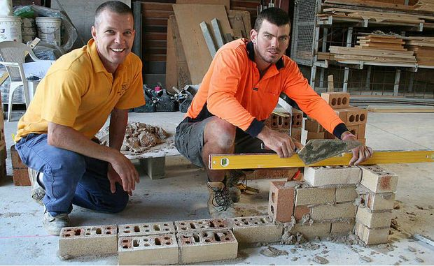 Apprentice bricklayer Todd Richards was fine-tuning his bricklaying skills with the Central Queensland TAFE bricklaying teacher Peter Carr.