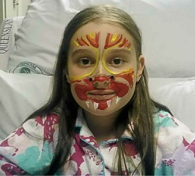 Maddy Litchfield, 9, had her face painted by a Ronald McDonald House volunteer this week while receiving treatment for leukemia.