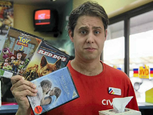 Civic Video owner Andrew Moore holds a selection of movies known to make even men cry.