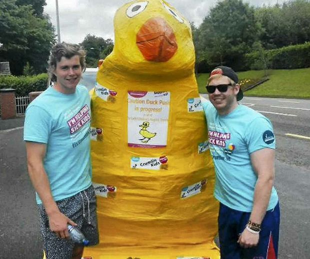 Henry Davidson and Allora's Matthew Kanowski take a break in the recent Clongowes Wood College annual charity duck push from Dublin to Limerick, in Ireland.