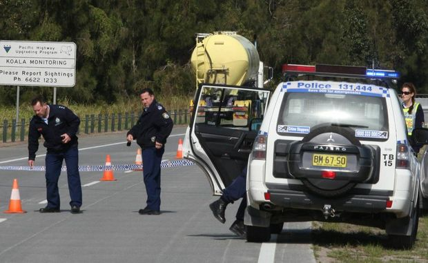 Police investigating a fatal accident on the Pacific Hwy, near Murwillumbah, on Monday.