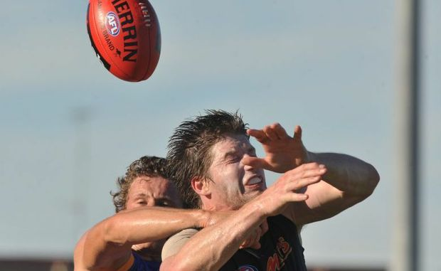 Carlton's Sam Rowe has his mark spoilt during a match against the Brisbane Lions.