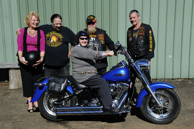 Volunteers Roz Petty (L) and Lyn Moore, along with Gladiators life-member Brad, vice-president Strawb and secretary Cliff, helped raise money to buy motorcycle helmets for kids in Vietnam.