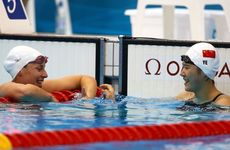 Alicia Coutts (left) has claimed silver behind China's Shiwen Ye in the women's 200 metre individual medley.