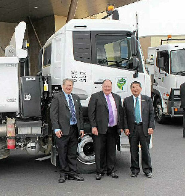 GOOD TIP: Lockyer Valley chief executive officer Ian Flint, mayor Steve Jones and Ageo City Mayor Minoru Shimamura with one of the council's UD tip trucks outside of the Lockyer Valley Cultural Centre during Mayor Shimamura's recent visit.