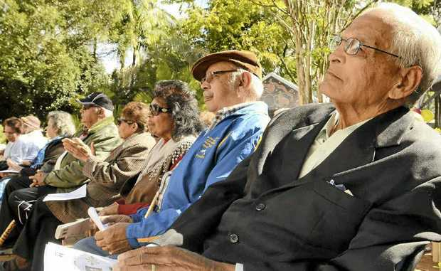 Yaegl Elder Uncle Kevin Randall and other elders watch over the launch of their Yaygirr Language Dictionary at the Maclean Tafe Campus on Friday.