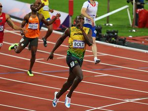 Bolt creates Olympic history with another gold