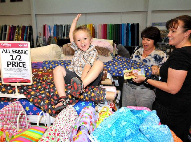 Lucas Aslette, Loren Boyd (centre) and Renee Aslette were excited by some of the bargains on offer at the opening of fabric and haberdashery chain Lincraft's Mackay store.