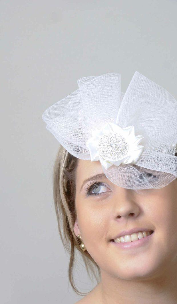 Zara Moorhead models a bridal headwear design by Virginia Hundt in preparation for tomorrow's Wedding Expo.