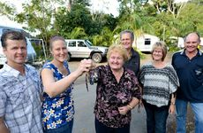 Ben and Renae Atherton are handed the keys to Cape Hillsborough Nature Resort by outgoing owners Robyn and Bill Shulkins and Merrilyn and Chris Westrop.