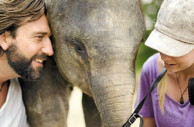 Murray Munro, Amanda French with Bona the baby elephant.