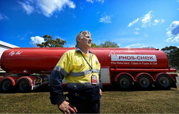 Operations manager of Phos-Chek, Jim Gilli, with the tanker that's been providing fire retardant, gel and foam for aerial firefighting in the Clarence region for more than a week.