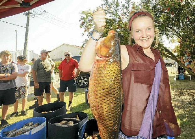 Winner of the junior section, 14-year-old Jamie Hancock of Evans Head with her 5.09kg carp.