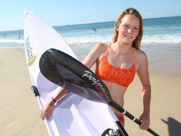 Ironwoman Maddy Dunn training at Mooloolaba Beach.