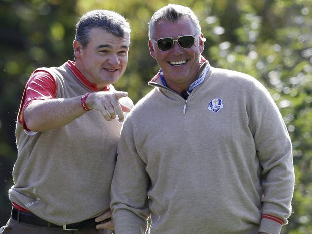 Europe's Paul Lawrie and Darren Clarke look over the 10th hole during a practice round at the Ryder Cup PGA golf tournament Thursday, Sept. 27, 2012, at the Medinah Country Club in Medinah, Ill.