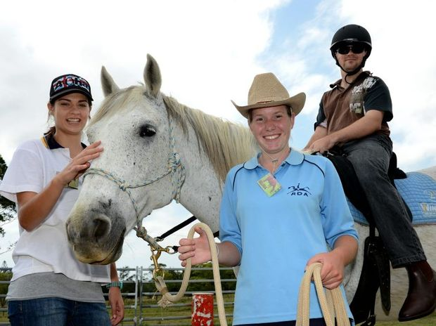 Jessica Baily, Melissa Wells and Jarred Heyning. Riding for the disable. Photo: John Gass / Daily News