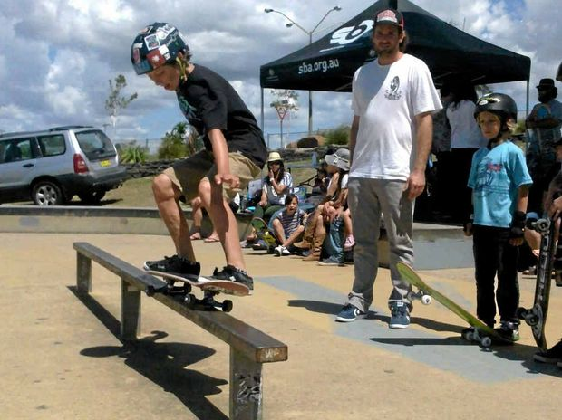 READY FOR ACTION: Ben Allen, from Lennox Head, took part in last Sunday's Northern Rivers Hub skating workshop in Ballina, organised by Hub manager Dylan McNamara, pictured watching Ben's form.