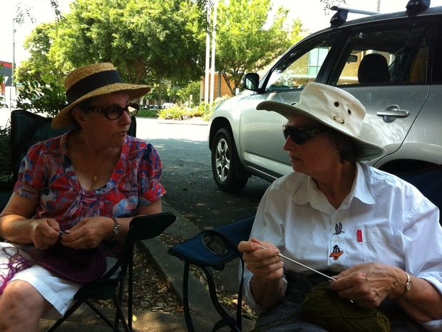 Maureen O'Shea, left, from South Grafton and Magda Mussared, from Waterview Heights knitting on the frontline of the Knitting Nannas protest against CSG outside Chris Gulaptis' office in Grafton on Friday.
