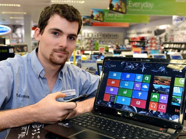 Harvey Norman Computers' Dennis Eagers with a computer using the new Windows 8 system, which will enable users to sync Windows phones and X-Boxes to their computer.
