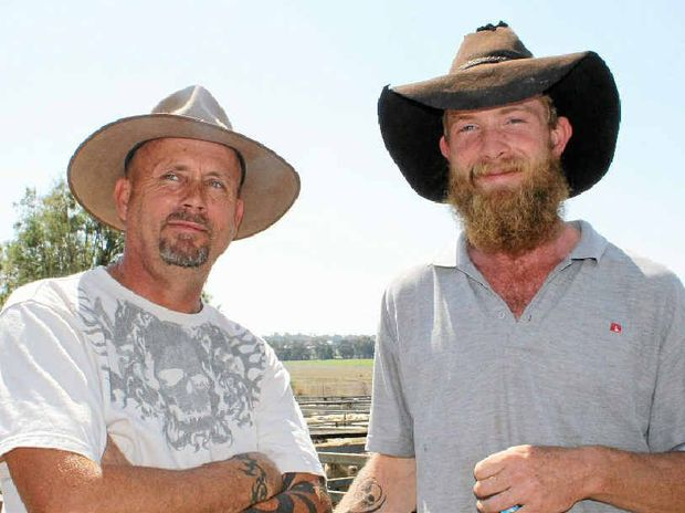 New Karara resident Brad Gough (left) and Pilton man Scott McInnes sheep sale.