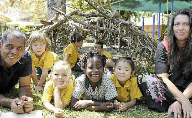 CROSS CULTURE: Luke Close and Penny Evans with Matilda Ryzak, Zawadi Brodie, Mirai Katagiri, Vinnie Morris, Aaron Spry and Tiggy Harling, in one of two gunyas built in the Bangalow school playground.