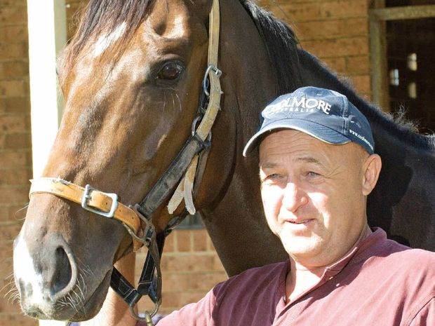 EYEING SUCCESS: Ballina trainer Stephen Lee, shown here with one of his stable Urnfield, has high hopes for his four entries in races tomorrow on his home track.