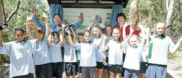 SEAL OF APPROVAL: National Parks Minister Steve Dickson and Maroochydore MP Fiona Simpson celebrate the reopening of the Mt Coolum walking track with local schoolchildren.