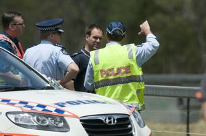 Emergency services investigate the fatal crash near Helidon.