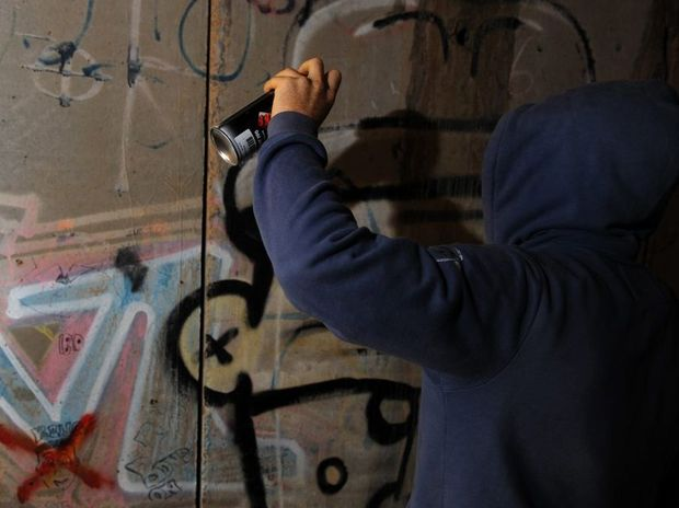 the steps in stopping graffiti related vandalism in the community Graffiti is a related property crime that involves the unauthorized writing or drawing on a wall or other surface under texas law, a person commits a graffiti offense if, without the consent of the owner, the person intentionally makes markings, drawings, or paintings on someone else's tangible property with:.