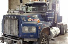 ROUGH START: When Jon Kelly first brought his old Mack Valueliner into PJ's for restoration work, owner Steve Lemon wondered how the job could be done in time.The process was filmed for the Foxtel series Mega Truckers. BELOW: Work begins on the truck. It is stripped back and repaired before being repainted, and a PJ's team member does some line marking.