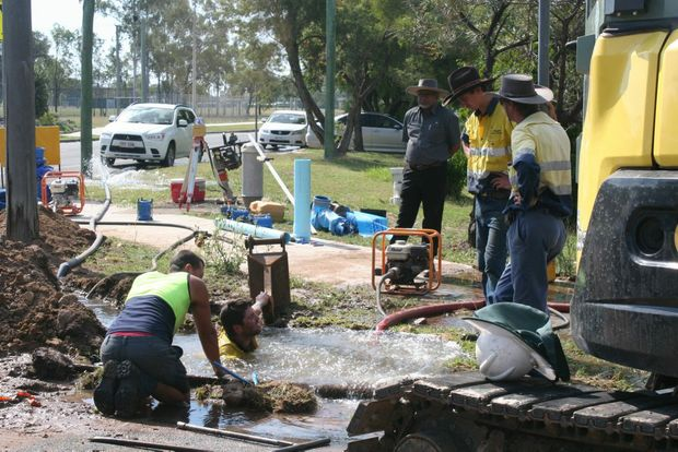 Council workers attempt to stop millions of litres of water from flowing out of a busted main on Monday. Photo Bec Elliott / Central Telegraph
