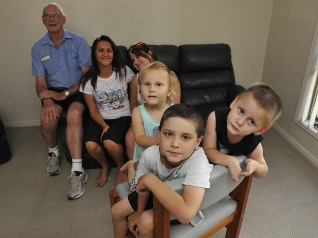 TO THE RESCUE: Mitchell Weier (centre) with his sister Lykiah and brother Jariah are happy that carpet cleaner Trevor Stewart (back) came to the families rescue. Mum Domonique and sister Tayla are seated with Trevor behind.