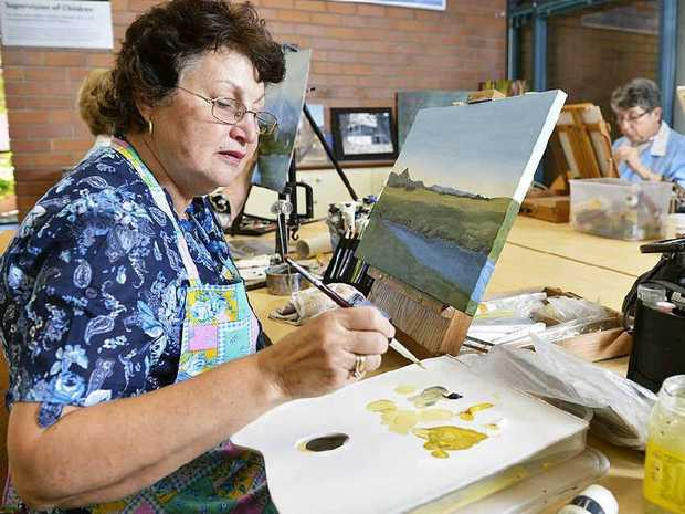 WORKS OF ART: University of the Third Age art class attendee Denise Taylor works on a painting for the U3A art show.